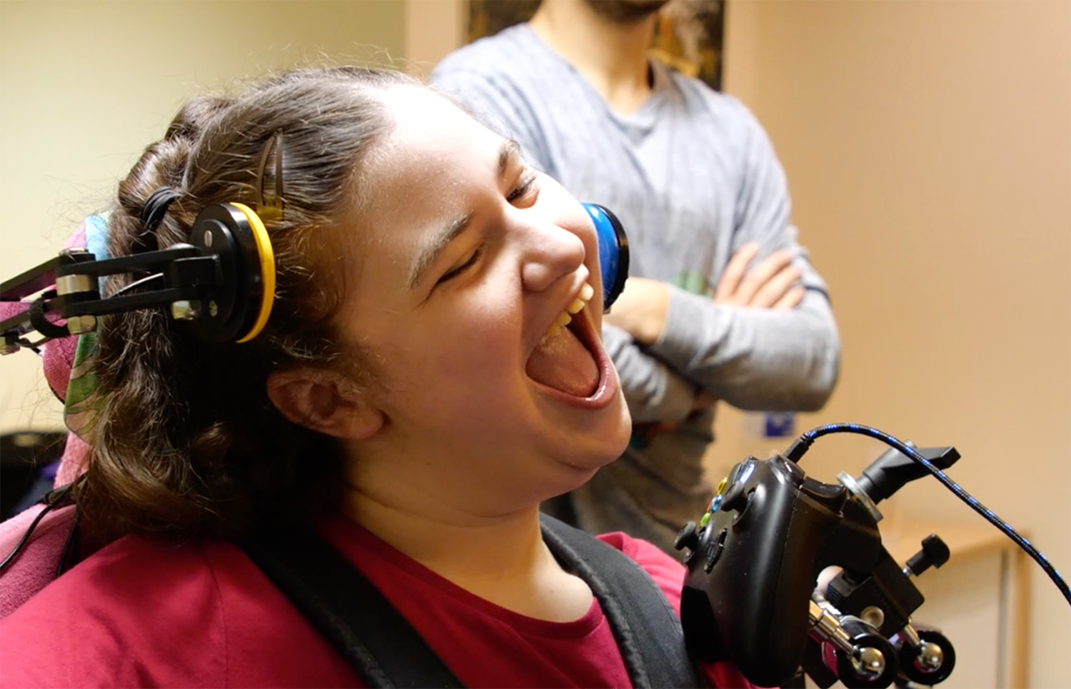 Close up of laughing girl and adapted games controller