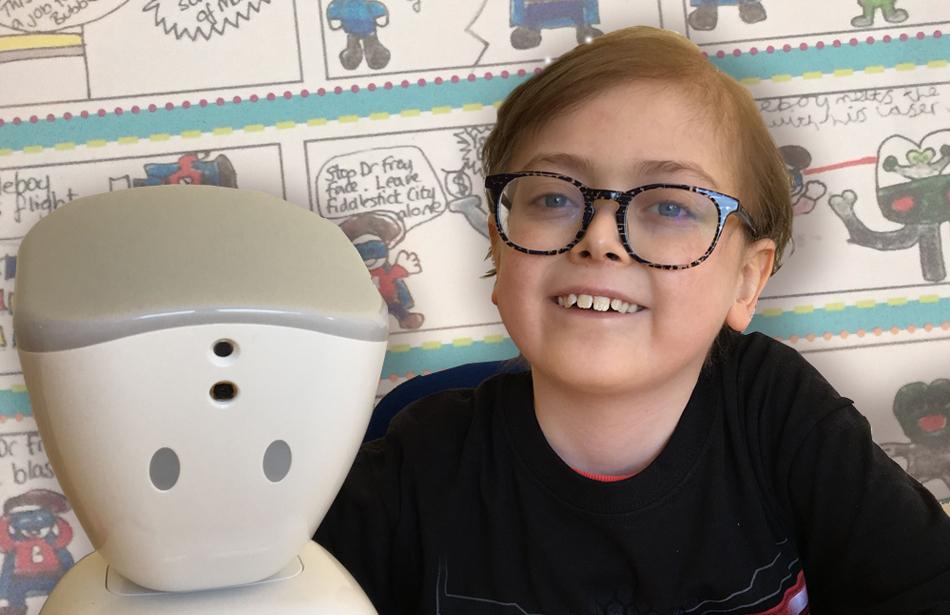 Close up of smiling boy alongside robot