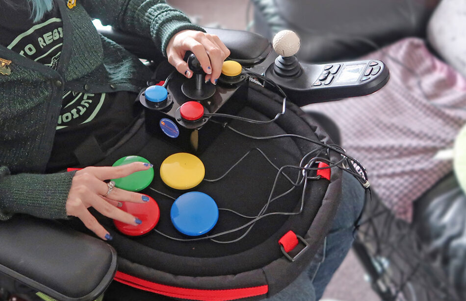 Close up of hands using adapted gaming control setup