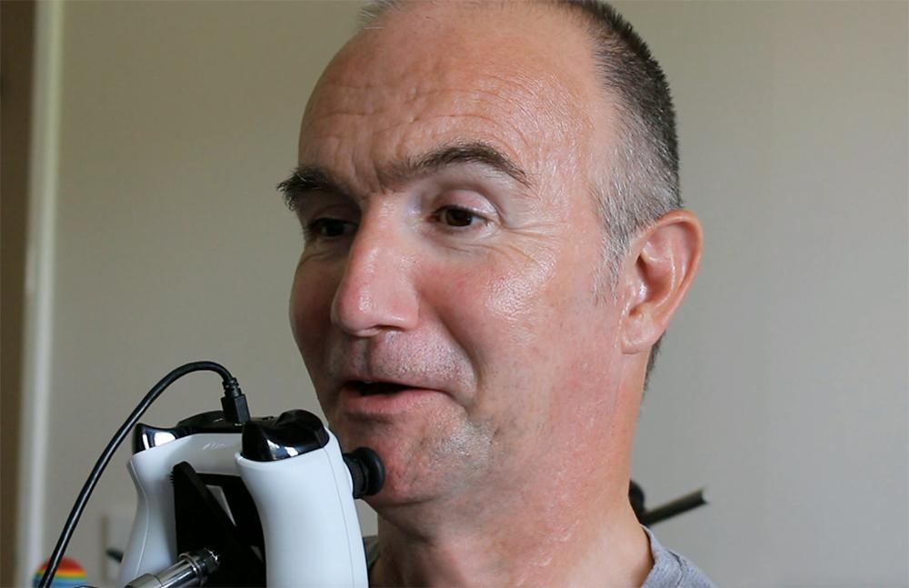 close up of man operating a chin joystick