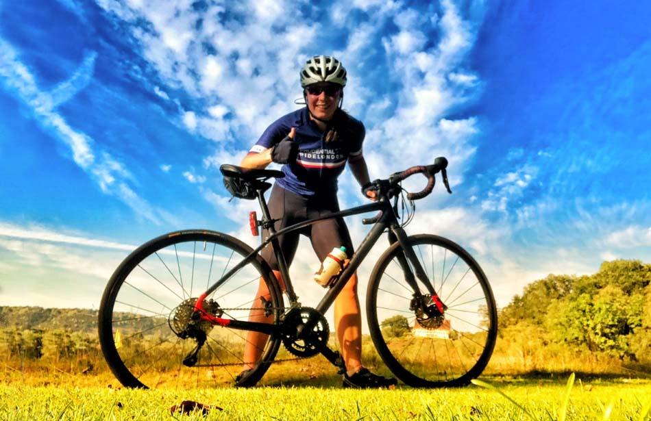 Smiling girl holding bike