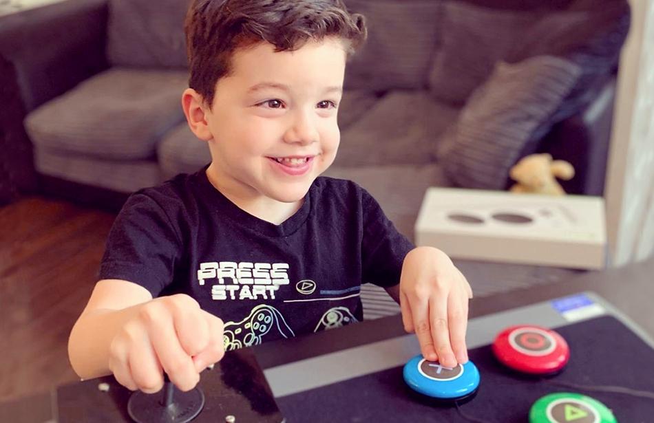 smiling boy playing video game
